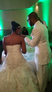 The lovely couple cutting the cake.